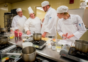 Students watch a Chef-Instructor's cooking demonstration